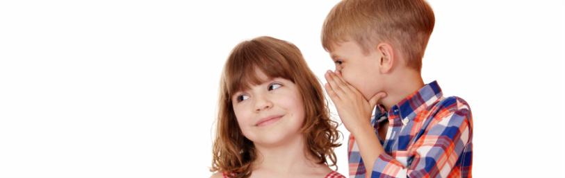 Picture of boy and girl whispering
